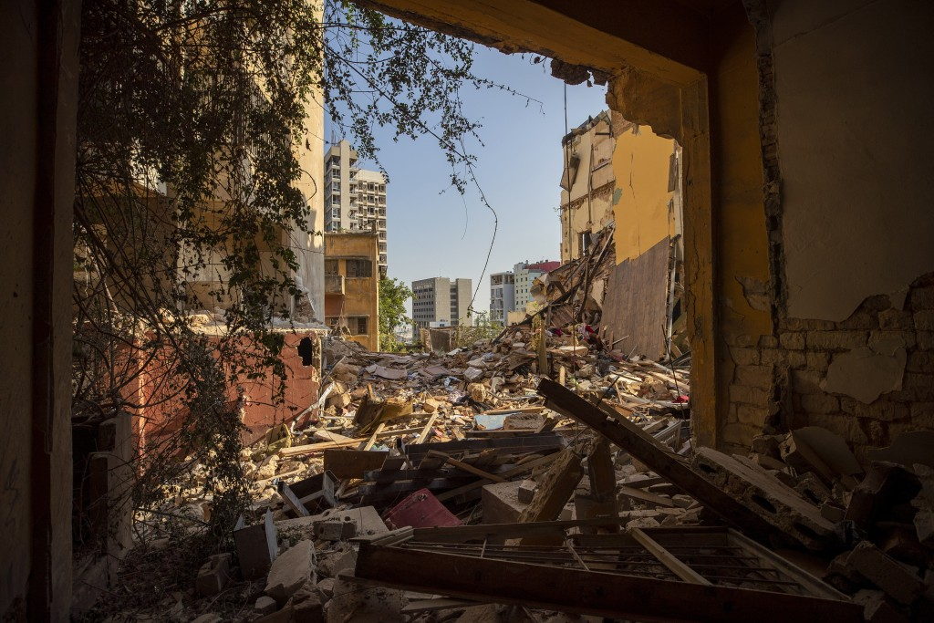 Destroyed buildings are seen from a room heavily damaged in a neighborhood near the site of last week's explosion that hit the seaport of Beirut Beiru...