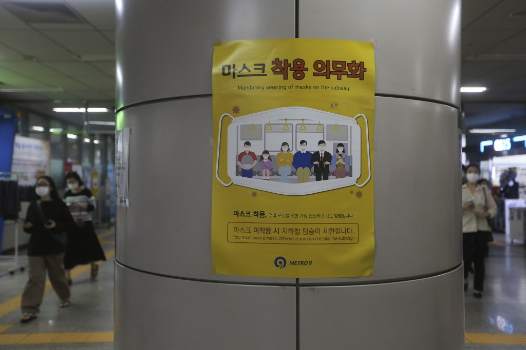 A poster on precautions against the coronavirus is displayed at a subway station in Seoul, South Korea, Wednesday, Aug. 12, 2020. Health authorities s...