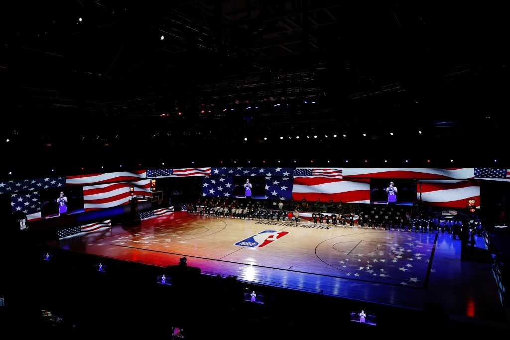 The New Orleans Pelicans and the Sacramento Kings take a knee during the National Anthem prior to the start of the game of an NBA basketball game Tues...