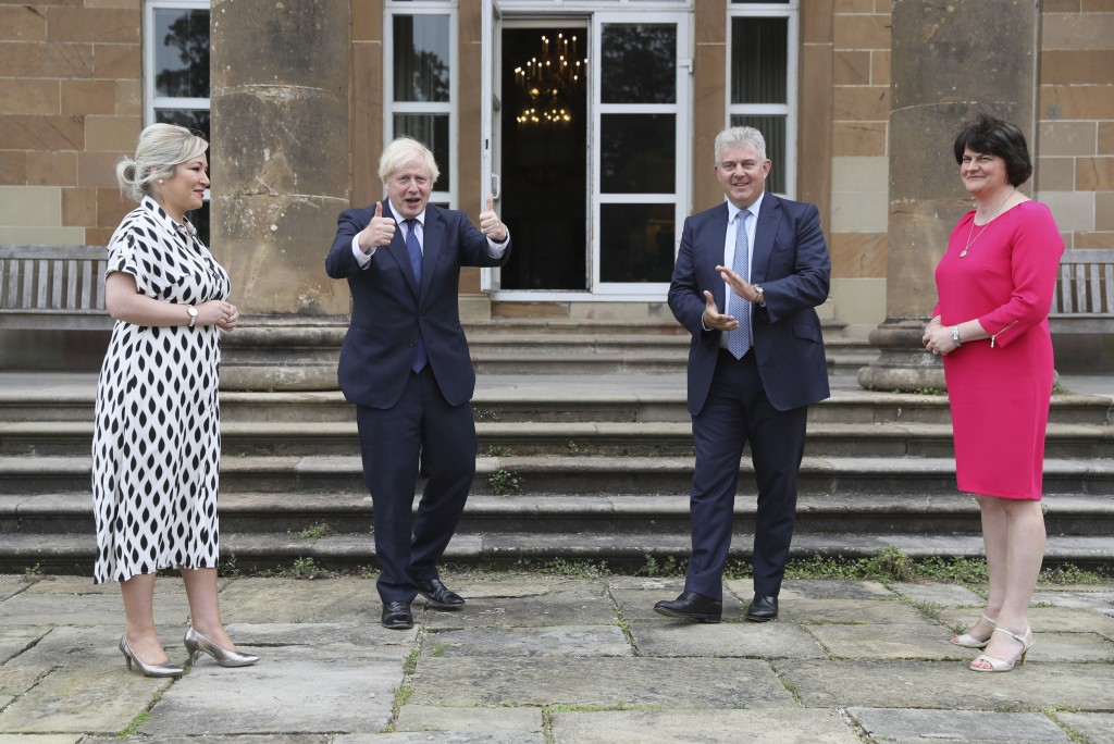 From left, Northern Ireland's Deputy First Minister Michelle O'Neill, Britain's Prime Minister Boris Johnson, Northern Ireland Secretary of State Bran...