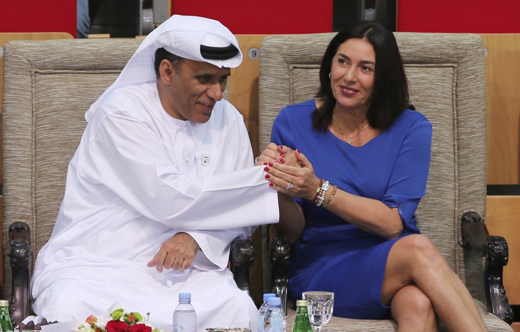 FILE - In this Oct. 27, 2018 file photo, Israeli Culture and Sport Minister Miri Regev, right, shakes hands with Mohamed Bin Tha'loob Al Derai, Presid...