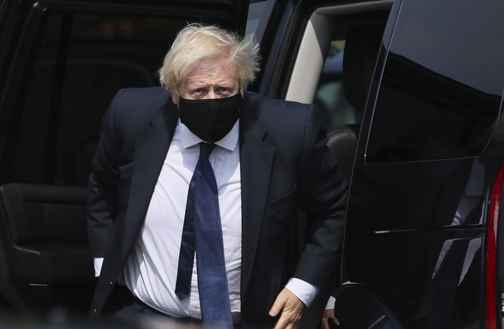 Britain's Prime Minister Boris Johnson arrives at the Northern Ireland Ambulance Service HQ during his visit to Belfast, Thursday, Aug. 13, 2020. (Bri...