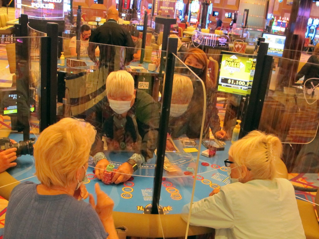 A dealer pushes a stack of chips to a winning gambler at the Hard Rock casino in Atlantic City, N.J. on July 2, 2020, the day the casino reopened amid...
