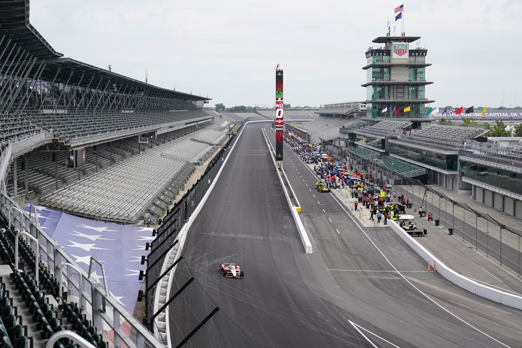 Drivers head to the track as practice opened for the Indianapolis 500 auto race at Indianapolis Motor Speedway in Indianapolis, Wednesday, Aug. 12, 20...