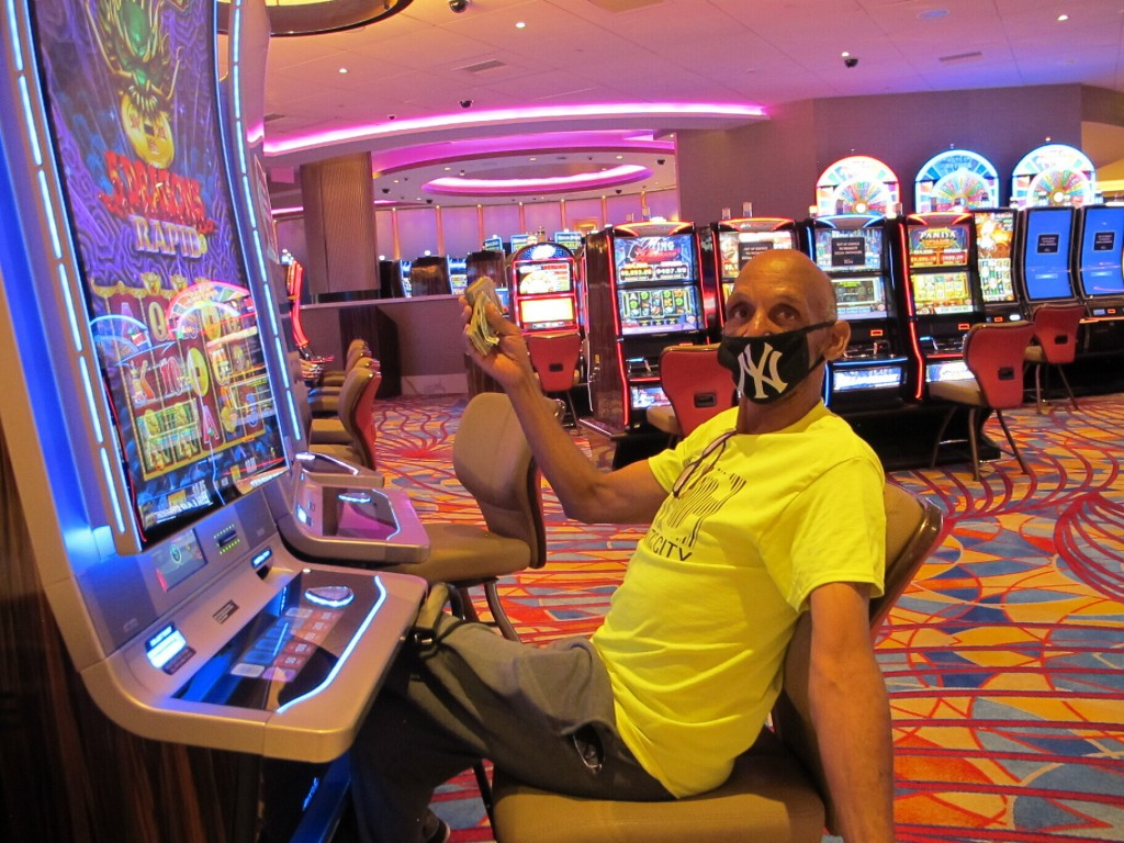 Gary Royster of Atlantic City holds up a wad of cash he used to gamble at the Hard Rock casino in Atlantic City on July 2, 2020, the day the casino re...