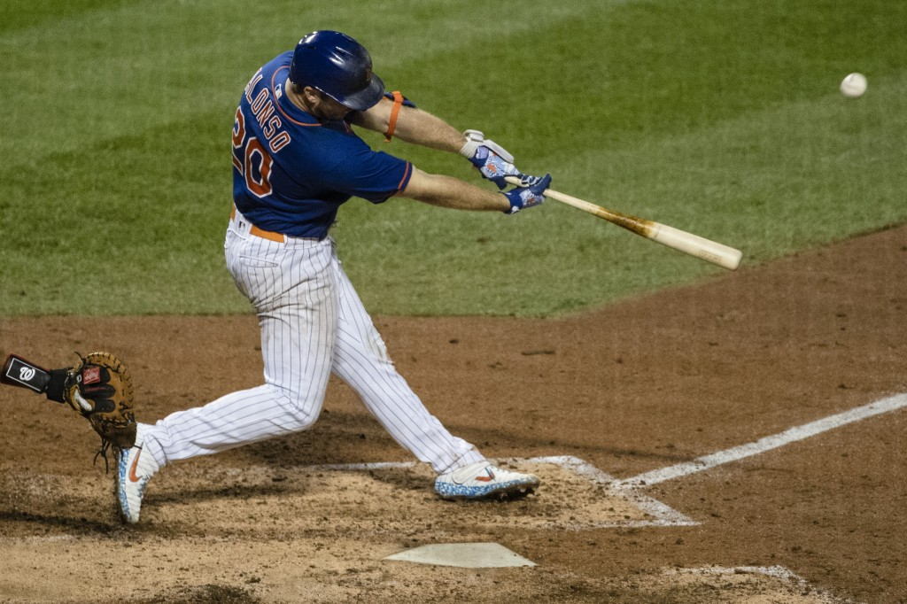 New York Mets' Pete Alonso (20) hits a two-run home run during the sixth inning of a baseball game against the Washington Nationals Wednesday, Aug. 12...
