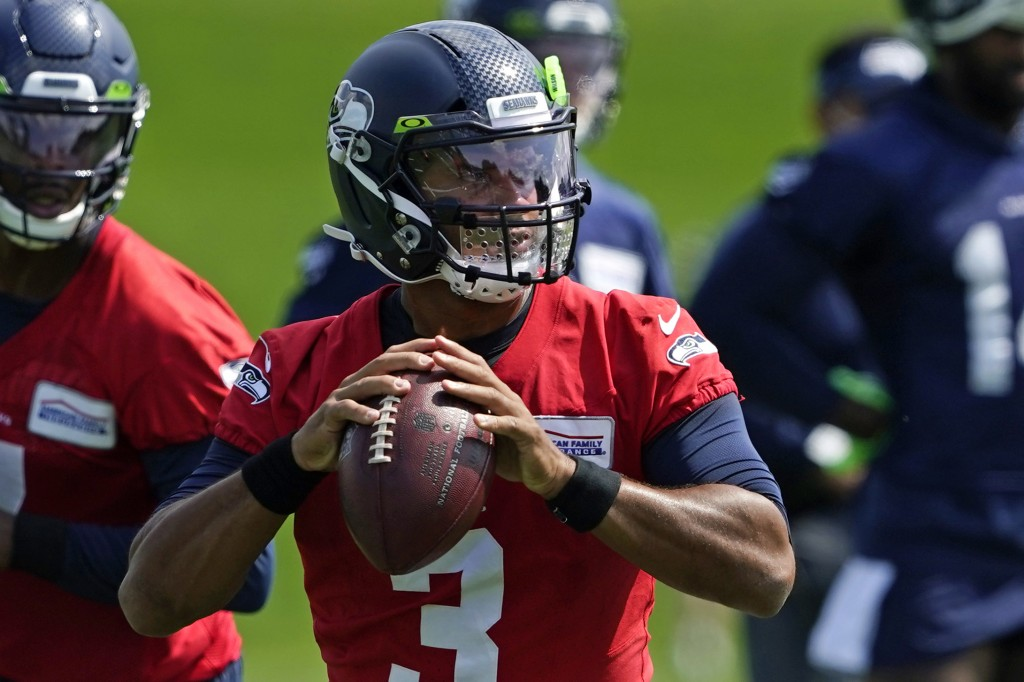 Seattle Seahawks quarterback Russell Wilson looks to pass during a practice drill at NFL football training camp, Wednesday, Aug. 12, 2020, in Renton, ...