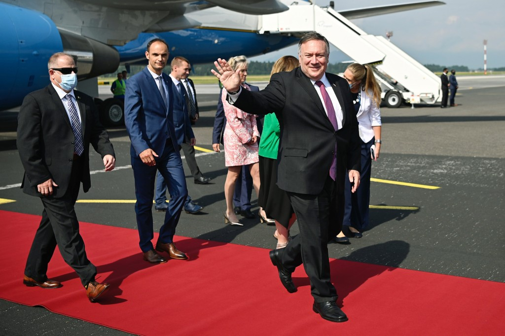 US Secretary of State Mike Pompeo, foreground, waves as he arrives at Ljubljana Joze Pucnik Airport, in Brnik, Slovenia, Thursday, Aug. 13, 2020. Pomp...