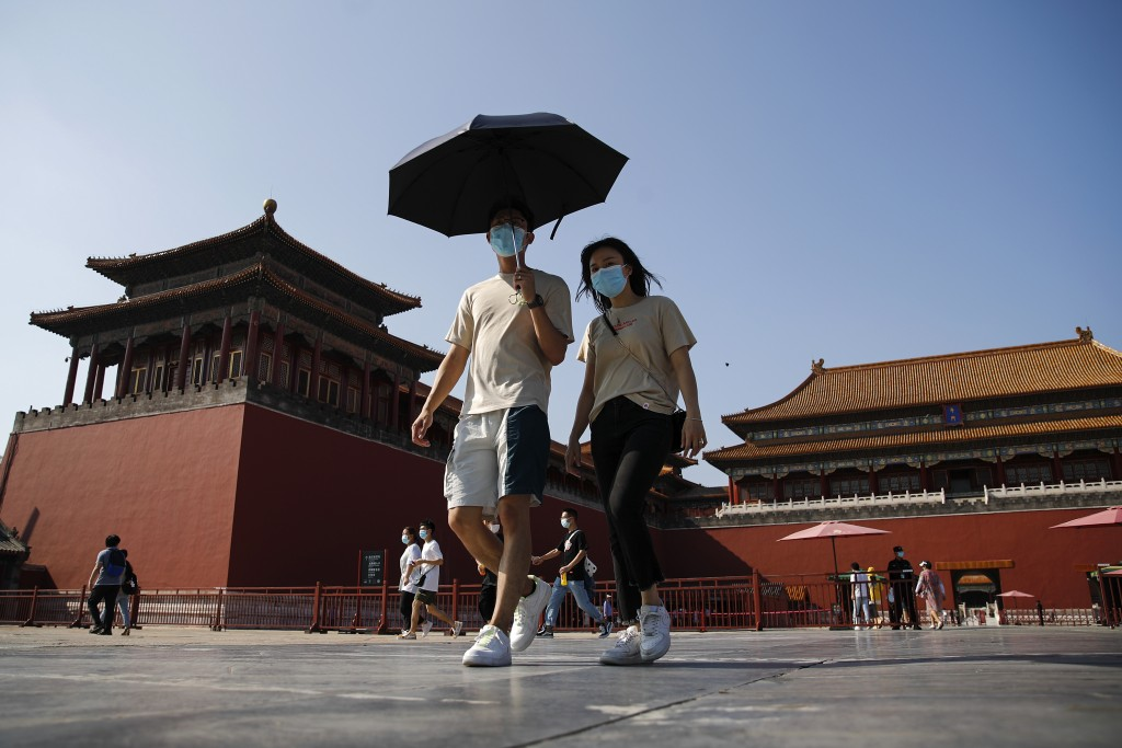 Visitors wearing face masks to help protect against the coronavirus visit Forbidden City in Beijing, Thursday, Aug. 13, 2020. New local cases in China...
