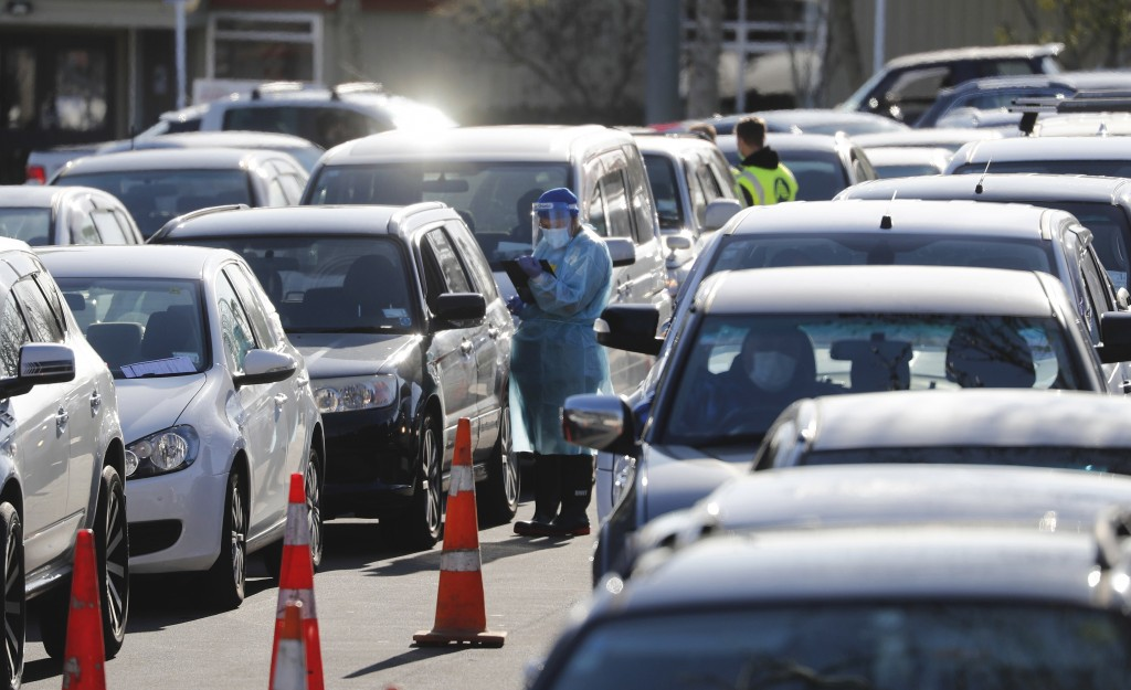 Cars queue at a COVID-19 test centre in Auckland, New Zealand, Thursday, Aug. 13, 2020. Health authorities in New Zealand are scrambling to trace the ...