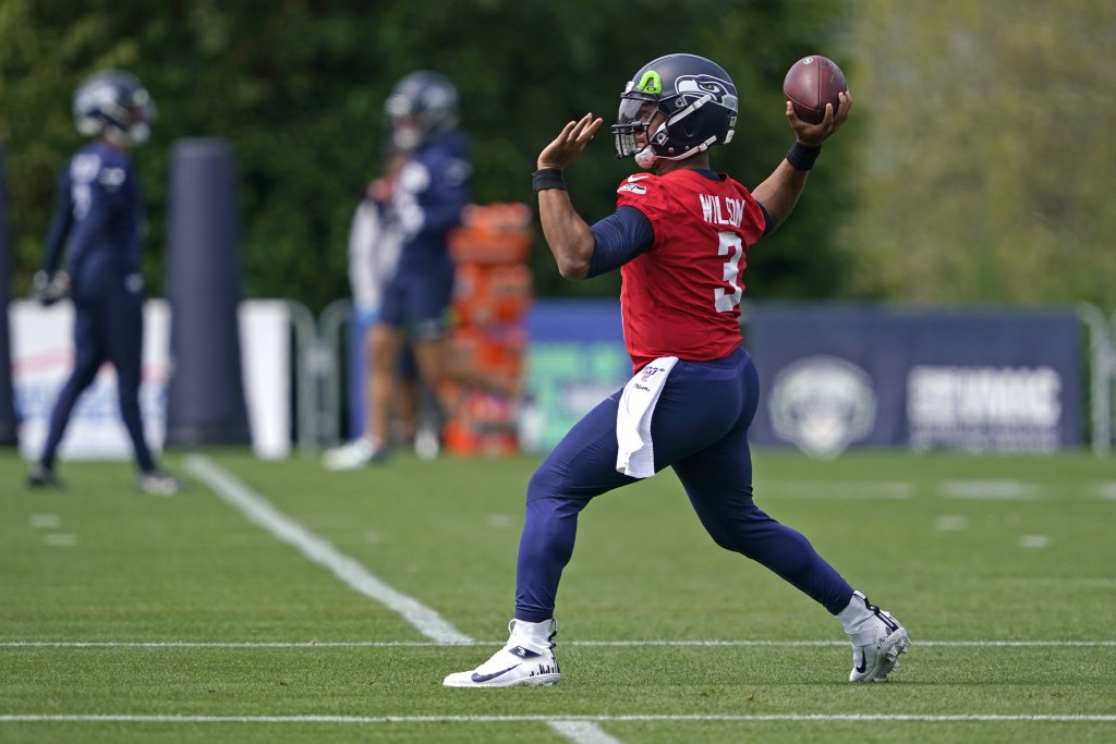 Seattle Seahawks quarterback Russell Wilson passes during a practice drill at NFL football training camp, Wednesday, Aug. 12, 2020, in Renton, Wash. (...