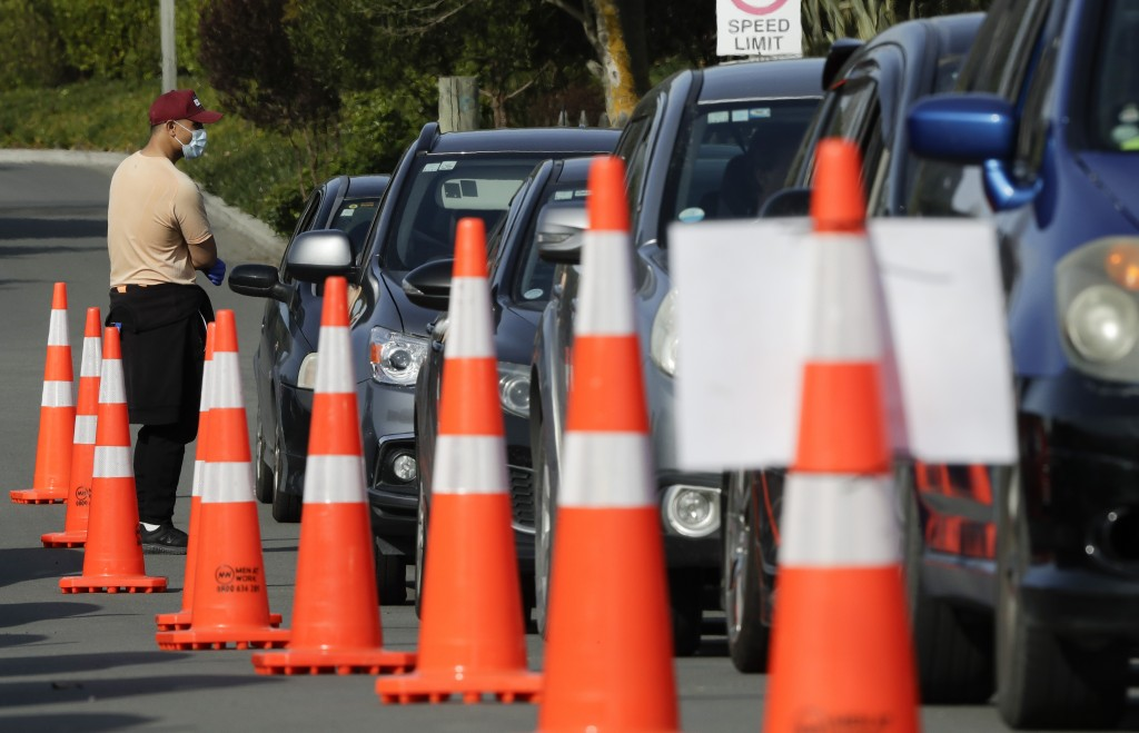 Motorists wait to take a COVID-19 test at a drive through community based assessment centre in Christchurch, New Zealand, Thursday, Aug. 13, 2020. Hea...