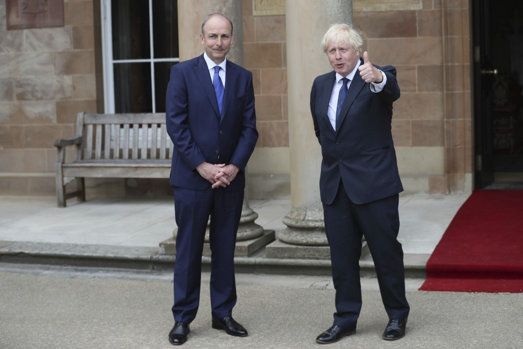 Britain's Prime Minister Boris Johnson, right, and Prime Minster of Ireland Michael Martin greet the media at Hillsborough Castle during his visit to ...