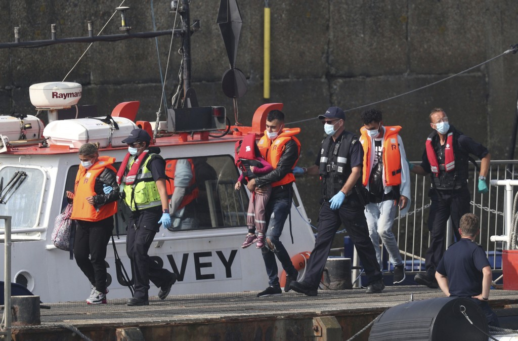 A group of people thought to be migrants are escorted by Border Force officers following a number of small boat incidents in the Channel, Thursday, Au...