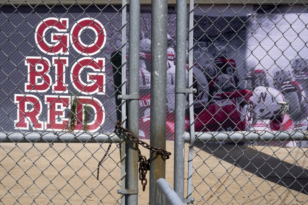 Gates leading into Memorial Stadium are padlocked, in Lincoln, Neb., Wednesday, Aug. 12, 2020. The Big Ten won't play football this fall because of co...