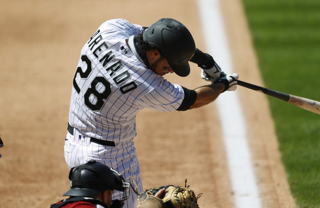 Colorado Rockies' Nolan Arenado connects for a solo home run off Arizona Diamondbacks relief pitcher Taylor Clarke in the fifth inning of a baseball g...