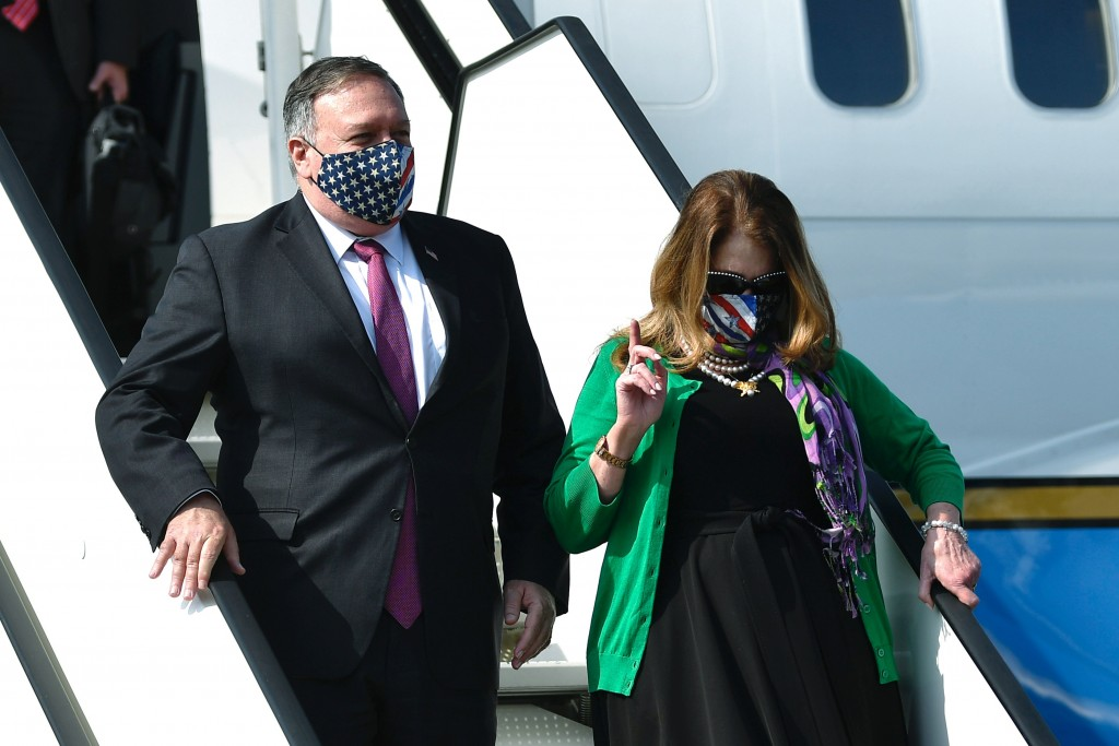 US Secretary of State Mike Pompeo, left, and his wife Susan, arrive at Ljubljana Joze Pucnik Airport, in Brnik, Slovenia, Thursday, Aug. 13, 2020. Pom...