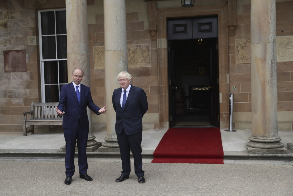 Britain's Prime Minister Boris Johnson, right, and Prime Minster of Ireland Michael Martin pose for the media at Hillsborough Castle during his visit ...