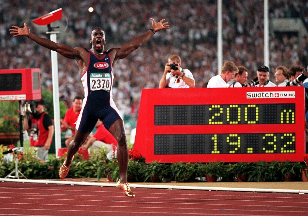 FILE -  In this Aug. 1, 1996, file photo, Michael Johnson, of the United States, celebrates after he won the men's 200 meter final in a world record t...