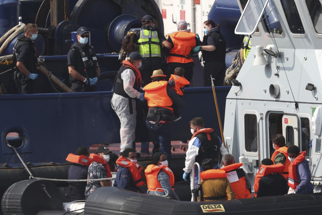 A group of people thought to be migrants are escorted by Border Force officers following a number of small boat incidents in the Channel, early, Thurs...