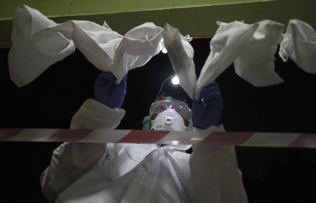 Professor from Kasetsart University Prateep Duengkae arrange bat prepare blood samples and taking swap samples from a bat's mouth inside Sai Yok Natio...