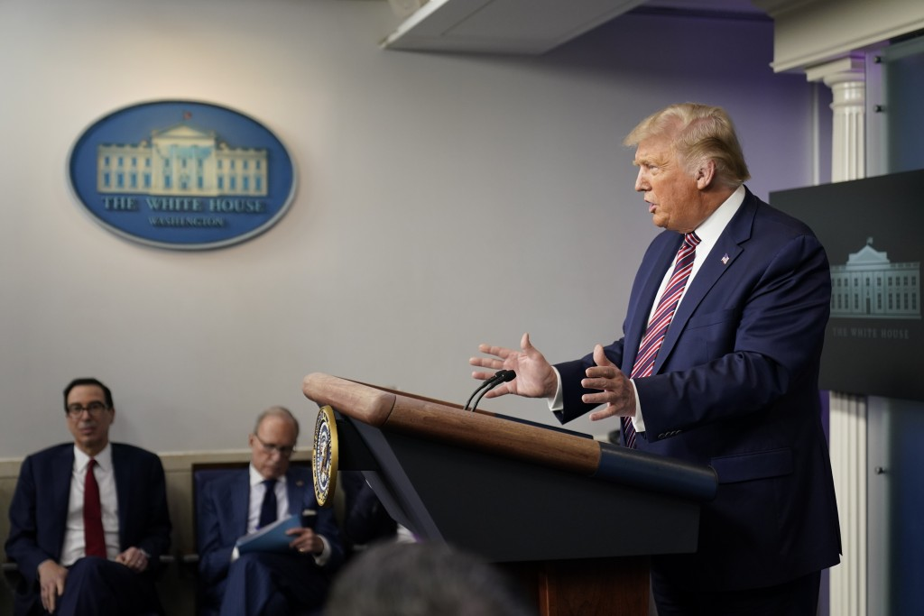 FILE - In this Wednesday, Aug. 12, 2020 file photo, President Donald Trump speaks at a news conference at the White House, in Washington. In a tweet o...