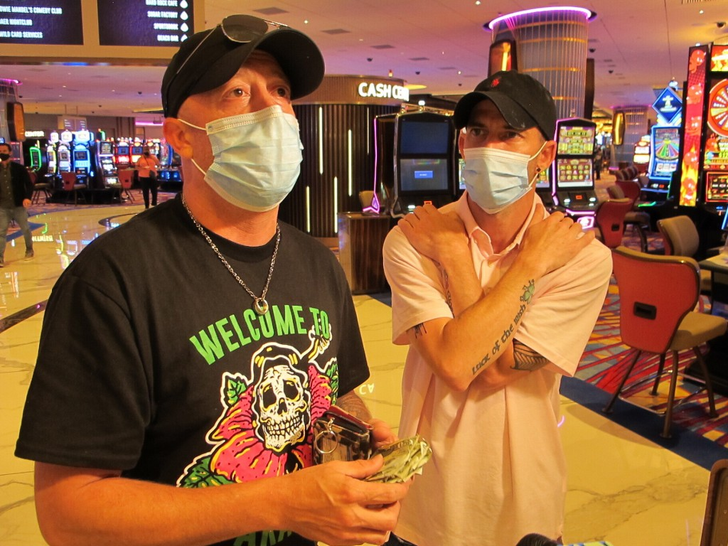 Mike McLaughlin, left, displays a wad of cash he and his friend Johnny Solis, right, planned to gamble at the Hard Rock casino in Atlantic City N.J. o...