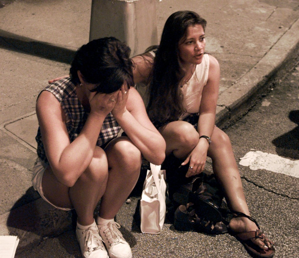 FILE - In this Saturday, July 27, 1996, file photo, Shelly Martin of Spokane, Wash., left, and Roselia Norwood of Hawaii react after an explosion occu...