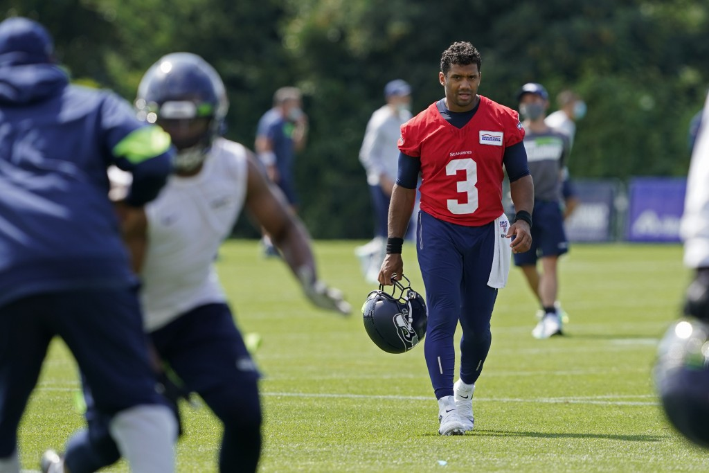Seattle Seahawks quarterback Russell Wilson (3) walks off the field after NFL football training camp, Wednesday, Aug. 12, 2020, in Renton, Wash. (AP P...