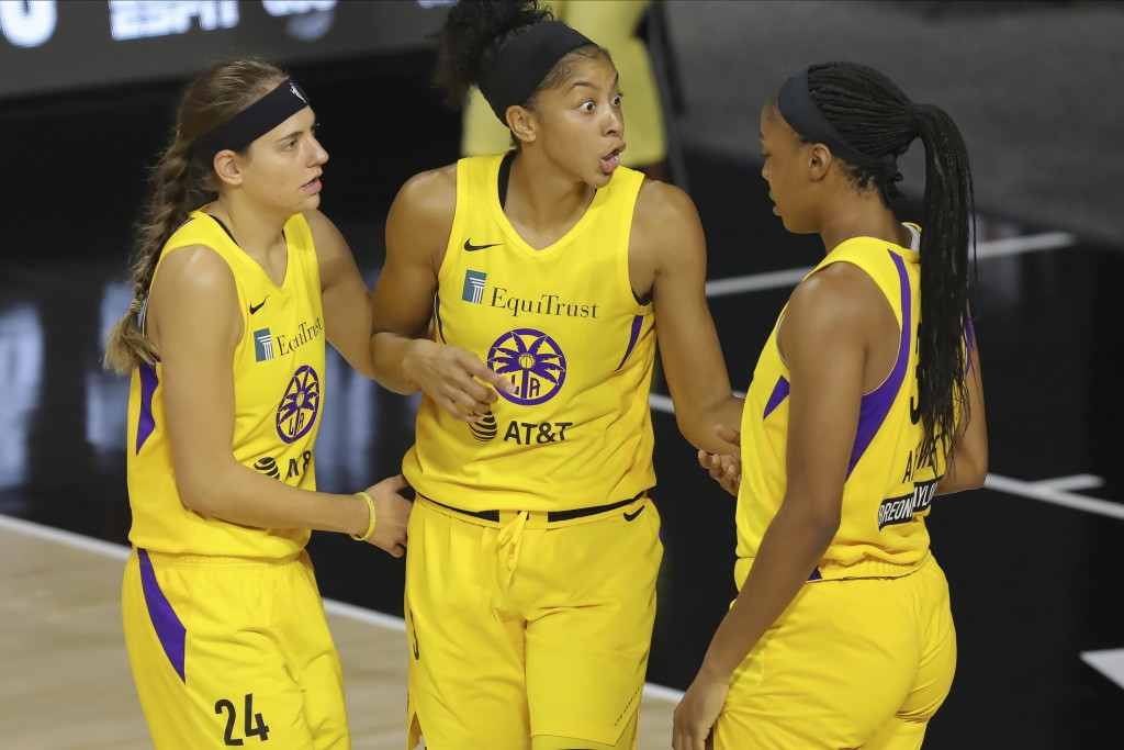 Los Angeles Sparks' Candace Parker, center, talks with Sydney Wiese (24) and Kristine Anigwe, right, during the first half of a WNBA basketball game a...