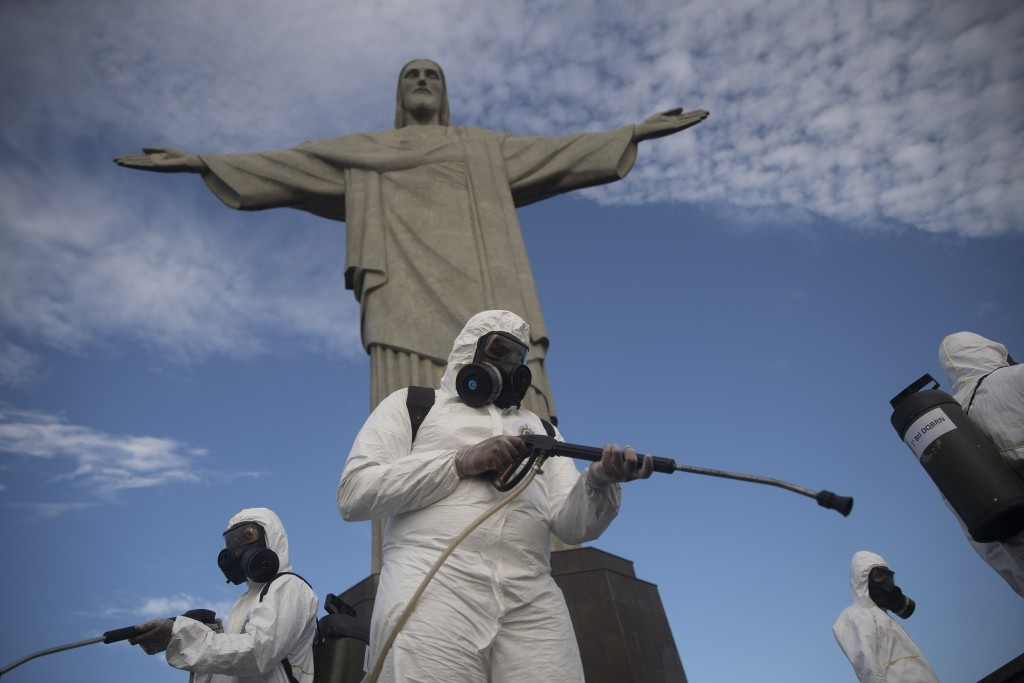 Soldiers disinfect the Christ the Redeemer site, currently closed, to prepare for what tourism officials hope will be a surge in visitors in the upcom...