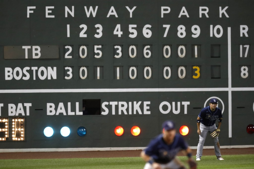 Tampa Bay Rays' Yoshitomo Tsutsugo, right, plays in left field during the ninth inning of a baseball game against the Boston Red Sox, Thursday, Aug. 1...