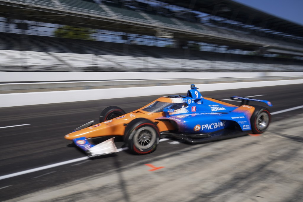 Scott Dixon, of New Zealand, leaves the pits during a practice session for the Indianapolis 500 auto race at Indianapolis Motor Speedway, Thursday, Au...