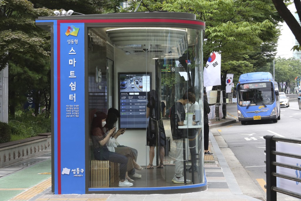 A bus shelter designed to block people with fever amid a spread of the coronavirus, is installed at a bus stop in Seoul, South Korea, Friday, Aug. 14,...