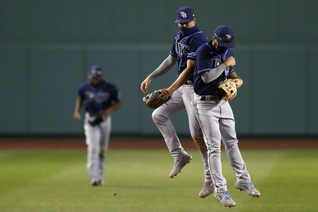 Tampa Bay Rays' Brandon Lowe, right, and Willy Adames celebrate after defeating the Boston Red Sox during a baseball game, Thursday, Aug. 13, 2020, in...