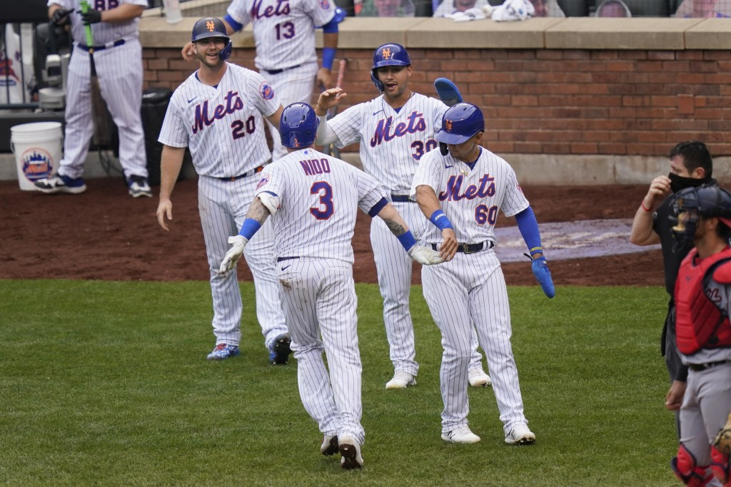 New York Mets' Tomás Nido (3) celebrates his grand slam with Pete Alonso, left, Michael Conforto, second from right, and Andres Gimenez during the fif...