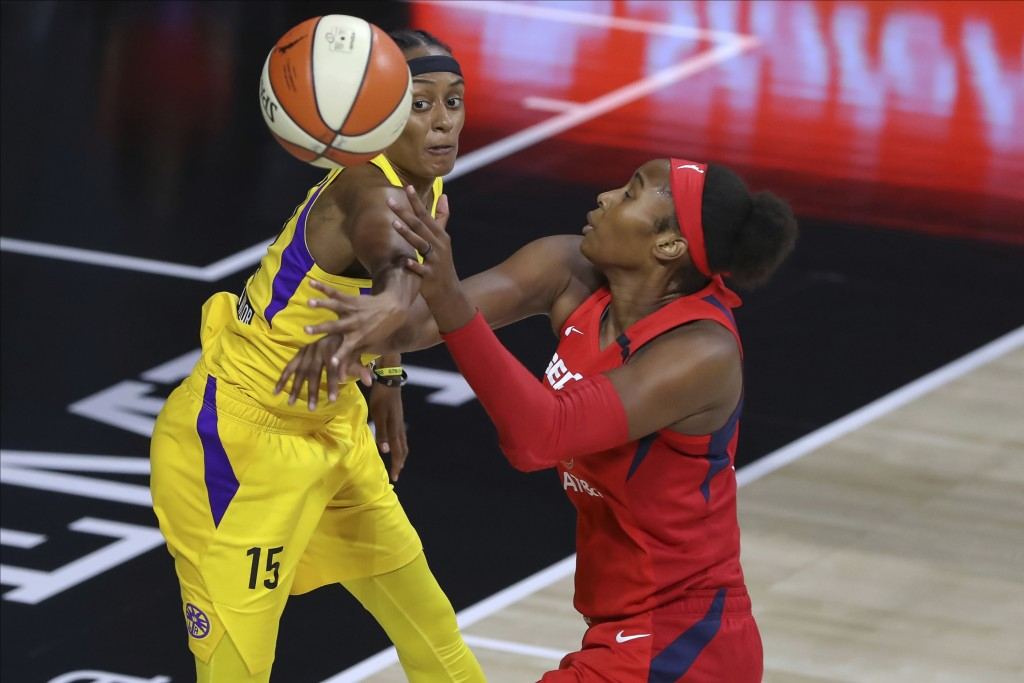 Los Angeles Sparks' Brittney Sykes (15) knocks the ball away from Washington Mystics' Alaina Coates during the first half of a WNBA basketball game Th...