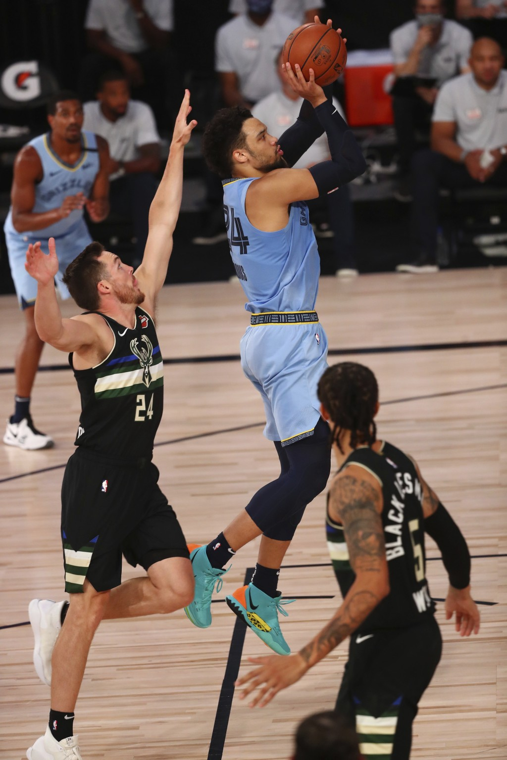 Memphis Grizzlies guard Dillon Brooks, top right, shoots against Milwaukee Bucks guard Pat Connaughton, front left, in the first half of an NBA basket...