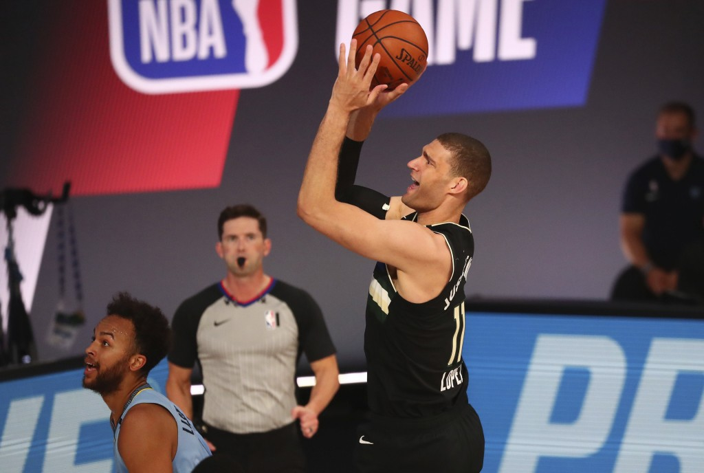 Milwaukee Bucks center Brook Lopez (11) shoots against the Memphis Grizzlies in the first half of an NBA basketball game Thursday, Aug. 13, 2020, in L...