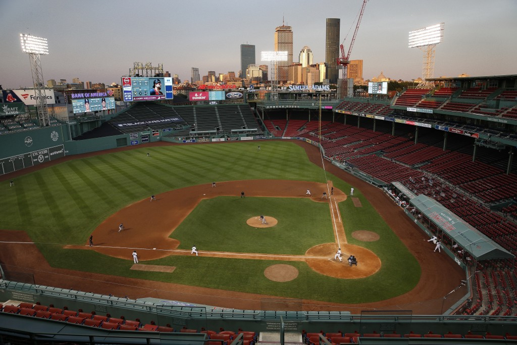 The Boston Red Sox play against the Tampa Bay Rays during the eighth inning of a baseball game at Fenway Park, Thursday, Aug. 13, 2020, in Boston. (AP...