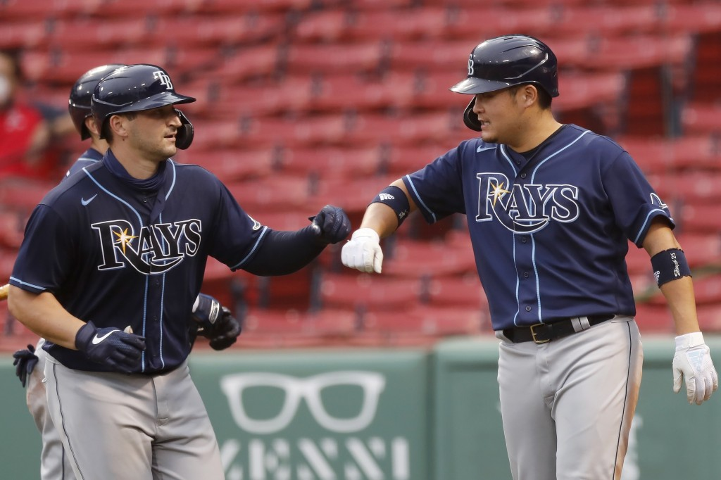 Tampa Bay Rays' Mike Zunino, left, celebrates his two-run home run that also drove in Yoshitomo Tsutsugo, right, during the sixth inning of a baseball...
