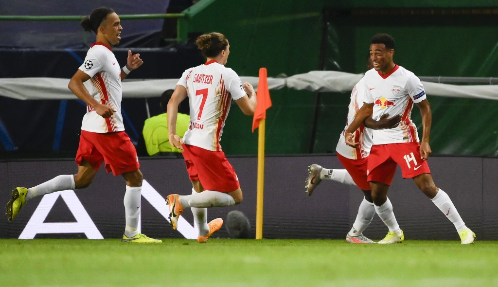 Leipzig's Tyler Adams, right, celebrates with teammates after scoring his team's second goal during the Champions League quarterfinal match between RB...