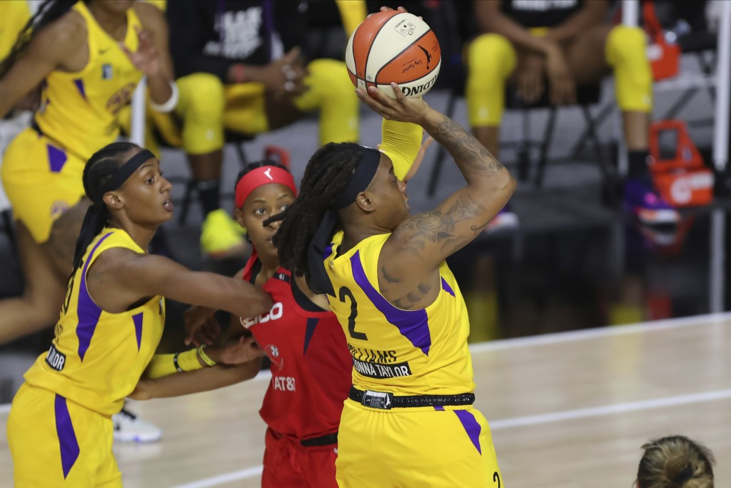 Los Angeles Sparks' Riquna Williams shoots against the Washington Mystics during the first half of a WNBA basketball game Thursday, Aug. 13, 2020, in ...