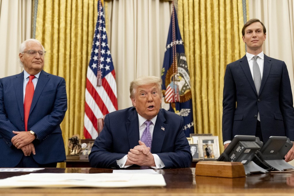 President Donald Trump, center, accompanied by U.S. Ambassador to Israel David Friedman, left, and Trump's White House senior adviser Jared Kushner, r...