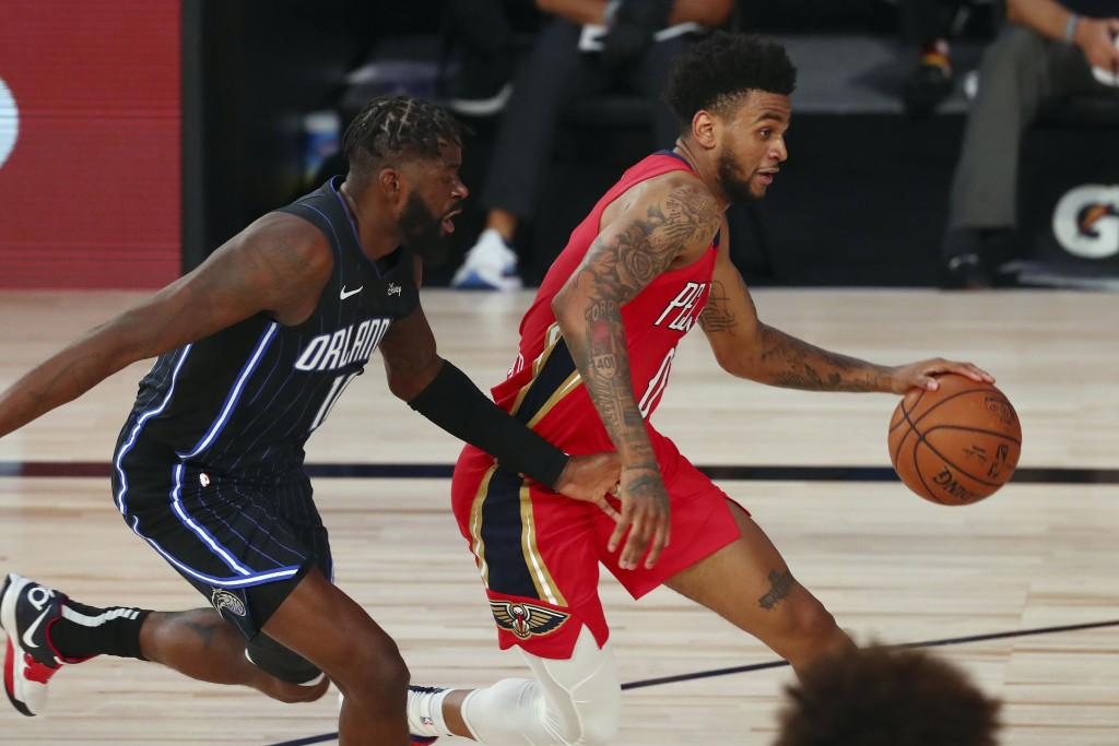 New Orleans Pelicans guard Nickeil Alexander-Walker (0) dribbles the ball against Orlando Magic forward James Ennis III (11) during the first half of ...