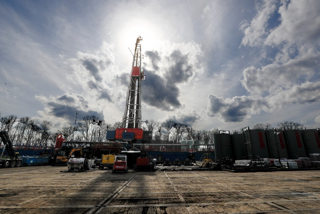 FILE - In this March 12, 2020, file photo, the sun shines through clouds above a shale gas drilling site in St. Mary's, Pa. President Donald Trump's a...
