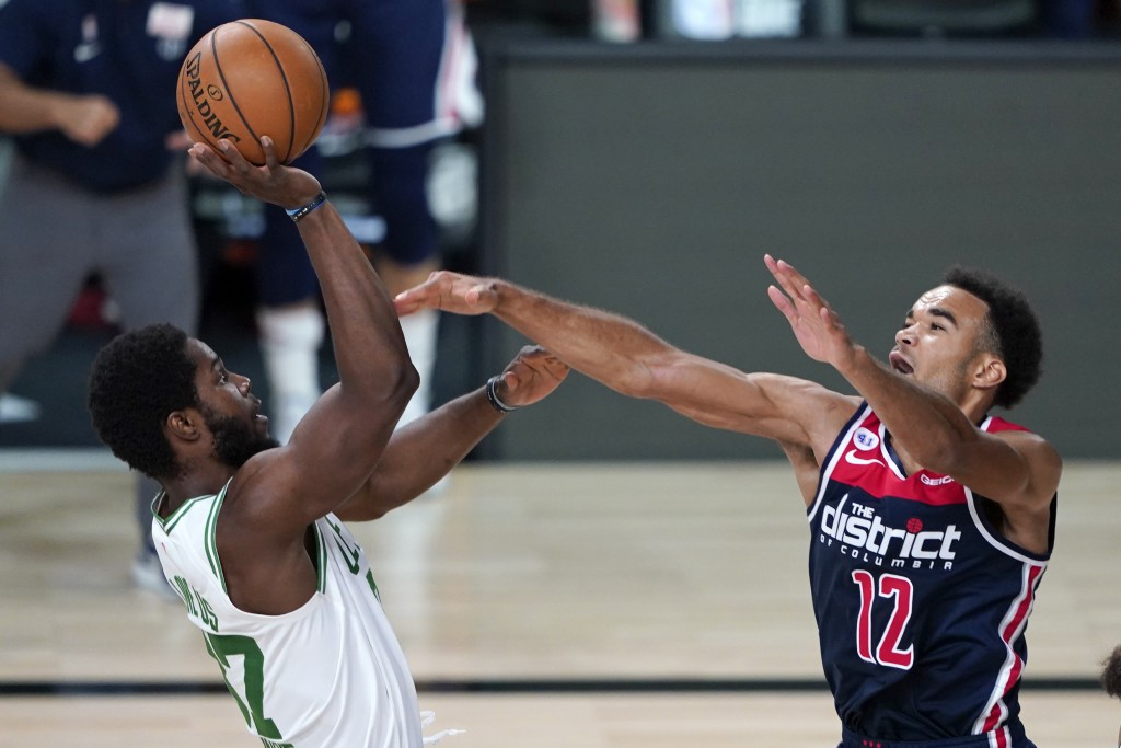 Boston Celtics' Semi Ojeleye, left, shoots as Washington Wizards' Jerome Robinson (12) defends during the second half of an NBA basketball game Thursd...