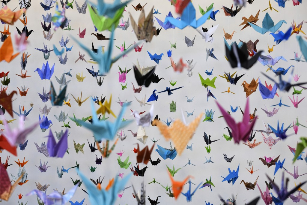 Origami paper cranes hang in the Matter Studio Gallery in Los Angeles during an exhibit for those who have died in the U.S. of COVID-19, on Tuesday, A...