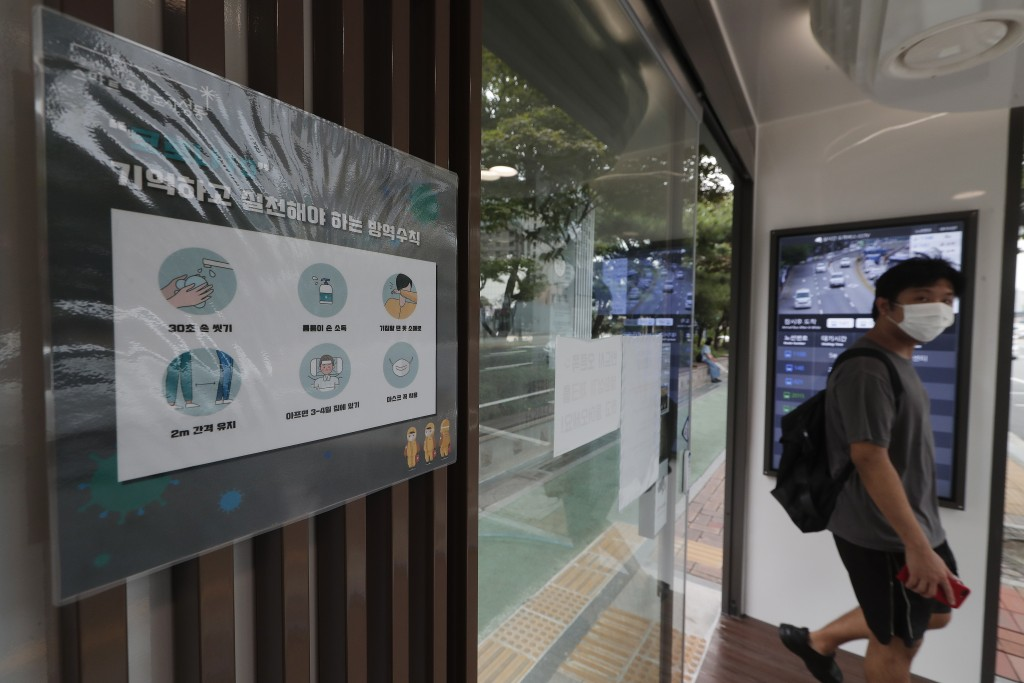 A poster on precautions against the coronavirus is displayed inside a bus shelter designed to block people with fever amid a spread of the coronavirus...
