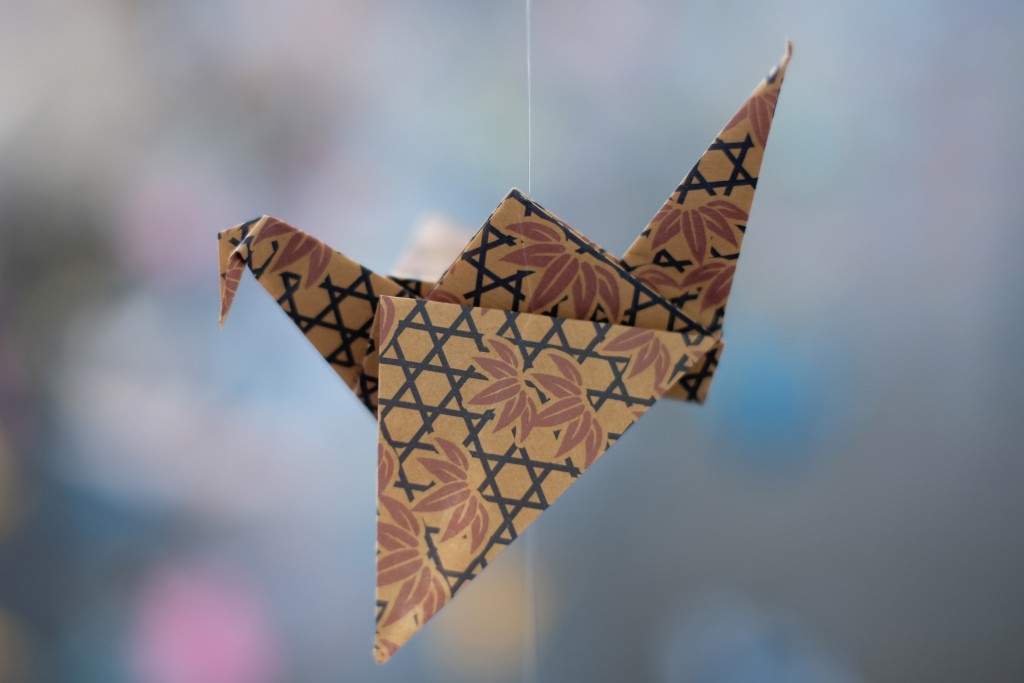 An origami paper crane hangs in the Matter Studio Gallery in Los Angeles, among thousands of others during an exhibit for those who have died in the U...